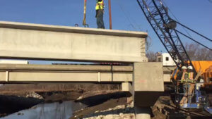 Beams are place atop the Warren County Bridge span.