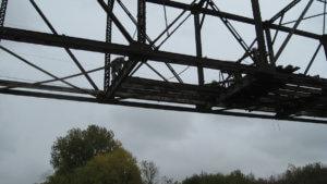 Grand Avenue bridge construction begins.