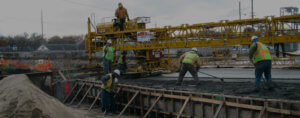 Workers pour concrete on the Grand Avenue bridge.