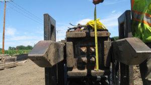 Herberger team members measure the length of piles.