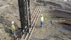 Herberger Construction team members undergo construction work on the Massena sliding bridge project.