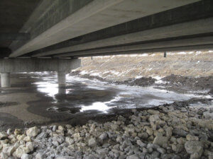 Beneath the DSM River bridge by Herberger Construction.