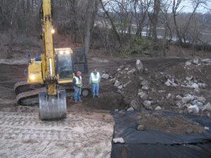 Workers gather around the LaPorte bridge site.