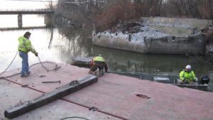 Herberger crews work on the demolition of an Ottumwa bridge.