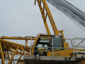 Side view of a Herberger yellow crane.