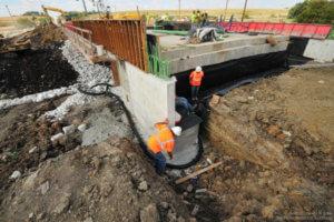 Workers inspect progress on the bridge.