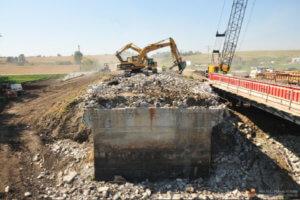 Crews demolish the old Massena bridge.