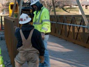 Crew members discuss bridge progress.
