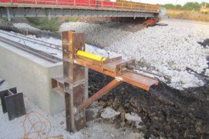Massena Bridge sliding track is constructed.