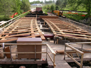 Flooring is placed within the bridge framework.