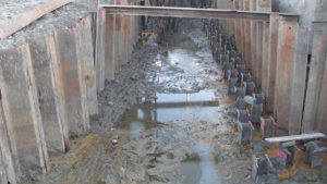 Muddy water sits at the bottom of support infrastructure on Grand Avenue.