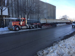 A truck carries a beam for the Middle River bridge.