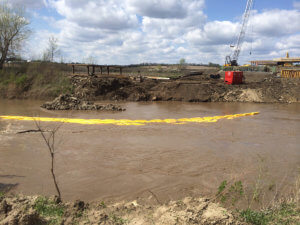 Water flows through the Middle River bridge project area.