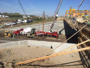 Crews and equipment line the Middle River bridge, completing different aspects of work simultaneously.