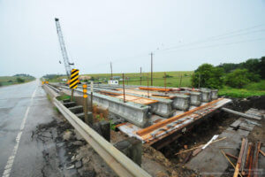 Beams lay across the Massena bridge gap.