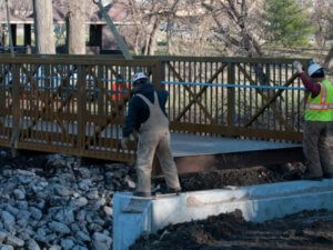Crew members guide the placement of Walker Johnston Bridge.
