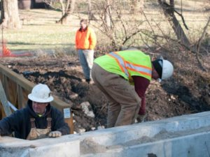 Crew members work on the Walker Johnston Park bridge.