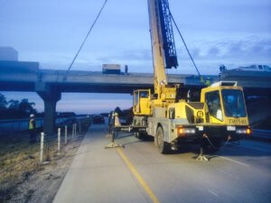 A beam is removed from a bridge on I-35 in Warren County.