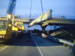 Herberger crews work with a crane operator to replace a beam on I-35 Northbound in Warren County.
