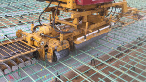 Concrete finishing equipment is prepared for use.