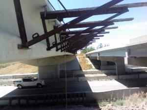 Warren County I35 bridge beams are worked on.