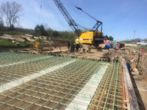 The Otter Creek bridge is worked on by crew members.