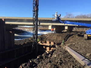 Crews work together to create a deep support system for the North River bridge.