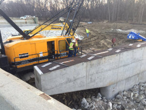 Crews prep the North River project for beam placement.