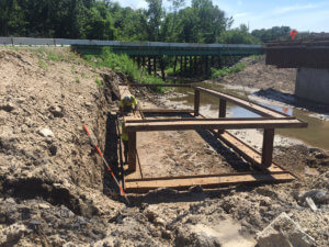 Supports and reinforcements are placed along the Bear Creek bridge site.