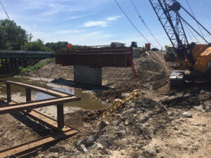 Bridge supports are constructed over the Bear Creek.