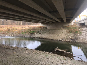 Water beneath a Warren County bridge.