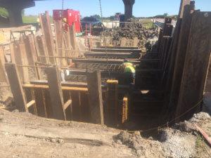 Crew members lay foundations for a bridge in Warren County.