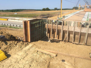 Construction crews span the gap over a Warren County highway.