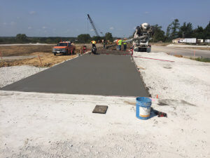Workers pour cement on a Warren County road.